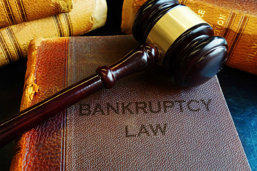 gavel on law books for refinance after bankruptcy