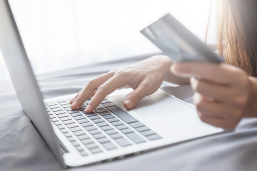 person using a computer for credit card debt refinancing