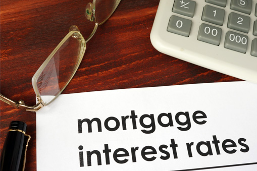 items on desk highlighting interest rates for mortgage loan